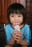 Girl drinking yogurt Stock Photo