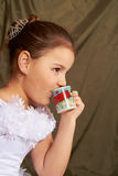 Girl drinks Royalty Free Stock Photo