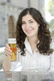 Girl drinks beer. Outdoor, church is background Royalty Free Stock Image