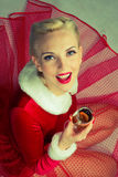 Girl drinks champagne. Blonde girl in a red dress drinking champagne Stock Images