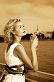 Girl drinks champagne Royalty Free Stock Photos