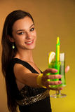 Girl drinks a cocktail in night club Stock Photos