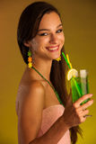 Girl drinks a cocktail in night club. Beautiful young woman drinks a cocktail Royalty Free Stock Images