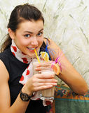 Girl drinks cocktail with sweet fruits Royalty Free Stock Image