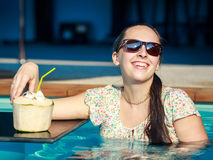 Girl drinks coconut Stock Image