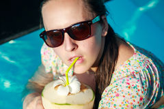Girl drinks coconut Stock Images
