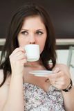 Girl drinks coffee Royalty Free Stock Photos