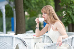 The girl drinks coffee Royalty Free Stock Images