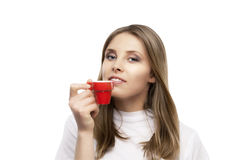 Girl drinks a coffee Royalty Free Stock Images