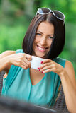Girl drinks coffee at the cafe Stock Photos