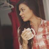 Girl drinks coffee Stock Photos