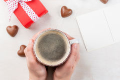 Girl drinks coffee on Valentine`s day Stock Photography