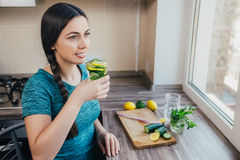 Girl drinks detox drink royalty free stock photography