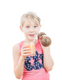 The girl drinks a grapefruit smoothie and holds a dumbbell. royalty free stock images