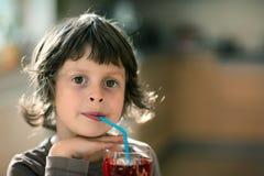 The girl drinks his lemonade Royalty Free Stock Photos