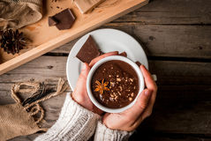 Girl drinks hot chocolate mug, with christmas present Royalty Free Stock Photo