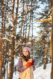 Girl drinks hot from a cup in winter. At sunset Royalty Free Stock Photos