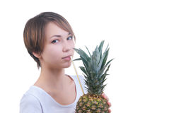Girl drinks juice from pineapple Royalty Free Stock Photos