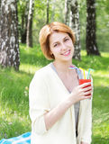 Girl drinks juice Stock Photography