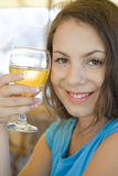 Girl drinks juice (wine) Royalty Free Stock Photography