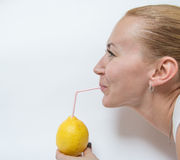 girl drinks lime Royalty Free Stock Photo