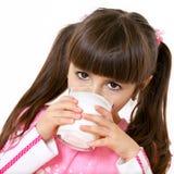 Girl drinks milk. Little beautiful girl drinking milk Stock Photos