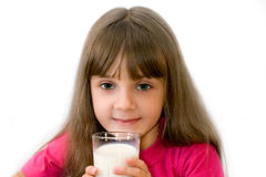 The girl drinks milk. The girl in a red blouse drinks milk from a glass Stock Photo