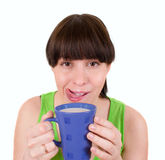 The girl drinks milk from a blue cup Stock Photo