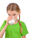 Girl drinks milk from a glass. Blonde Girl drinks milk from a glass. Isolated on white background Royalty Free Stock Photo