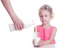Girl drinks milk. From glass isolated on white background Stock Photography