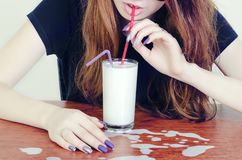 A girl drinks milk Stock Photos