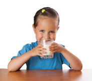 Girl drinks milk, isolated. On white Royalty Free Stock Photo