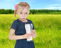 Girl drinks milk joke. Is stained with milk mouth.The concept of marital happiness and parenting Stock Photos