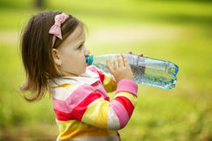Girl drinks mineral water Stock Images