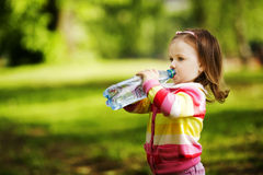 Girl drinks mineral water Stock Photography