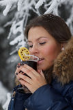Girl drinks mulled wine royalty free stock photography