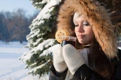 Girl drinks mulled wine Stock Photo