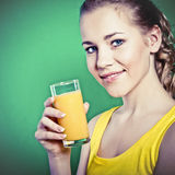 Girl drinks natural orange juice Royalty Free Stock Photo