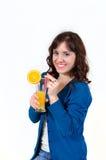 The girl drinks orange juice Stock Photo