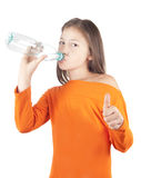 The girl drinks pure cold water.  Stock Image