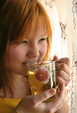 Girl drinks tea Stock Photography