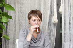 Girl drinks tea Stock Images