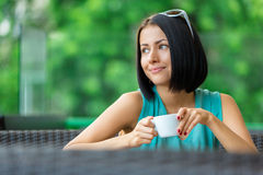 Girl drinks tea at the bar Stock Photo