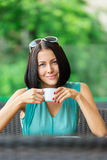 Girl drinks tea at the cafe Stock Image