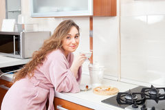 The girl drinks tea on kitchen Stock Photos