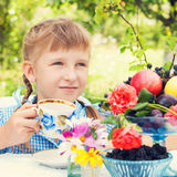 Girl drinks tea. outdoors. Healthy lifestyle. Stock Photography