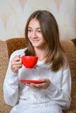 Girl drinks tea Stock Photography