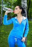 Girl drinks water Stock Images