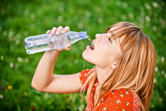 Girl drinks water Royalty Free Stock Image