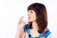 Girl drinks water Stock Photography